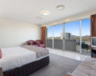 Bedroom in Executive Apartment - CBD Luxury Accommodation